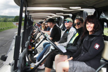 Golfers sit at the ready in their carts before shotgun
