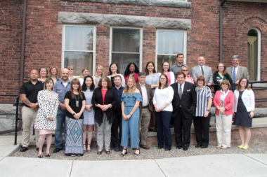 Leadership Cayuga Class of 2019 and alumni pose for a photo outside Euterpe Hall in Auburn, NY, on graduation day, May 30, 2019.