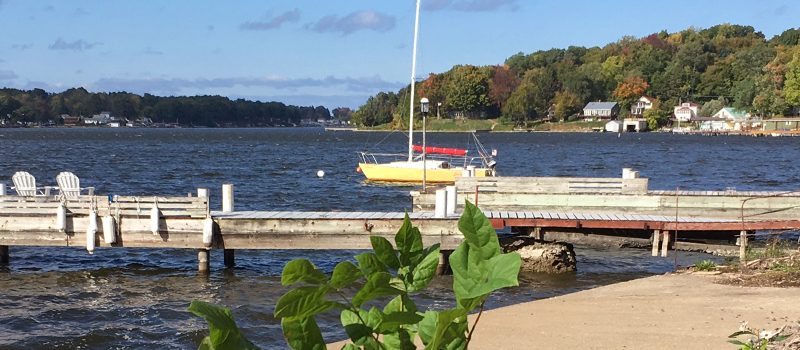 Sailboat on Cayuga Lake near a dock