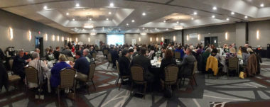 Attendees of the 2019 State of Cayuga County and City of Auburn Luncheon listen to a presentation March 2019 at Holiday Inn, Auburn.